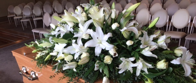 funeral flowers, lillies, classic white floral tribute,