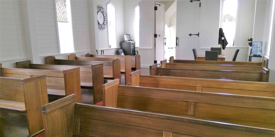 funeral chapel with wooden pews